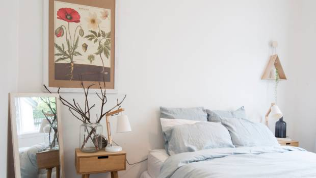In the bedroom, the botanical print is actually a piece of wrapping paper in a $5 frame.