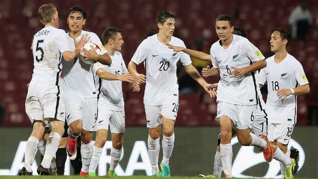 New Zealand captain Max Mata (second left) is congratulated after his 58th-minute goal against Turkey in Mumbai.