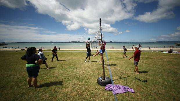 People enjoy the fine weather on the beach at Maraetai, Auckland.