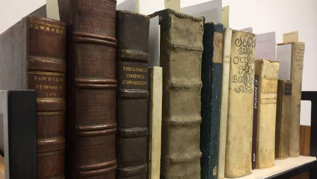 While some of the books' covers have been replaced, others remain in their originals.