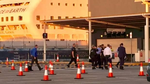 Investigators enter the cruise ship terminal in Brisbane on Sunday.