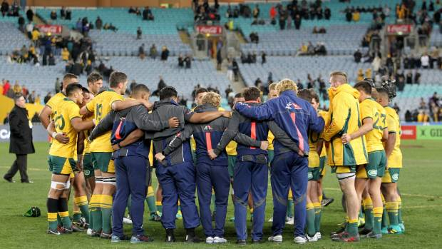 The Wallabies form a huddle after the final whistle in their heavy Bledisloe Cup defeat to the All Blacks in Sydney.