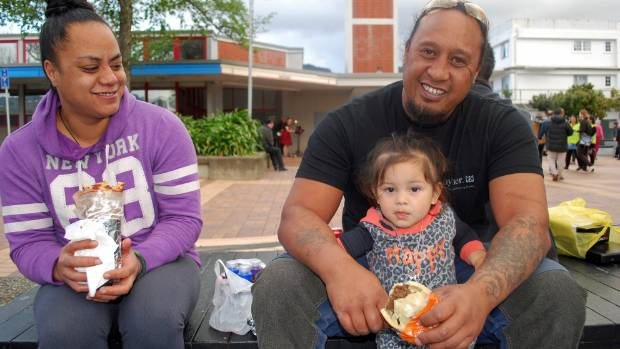 Karen Wilson, Charlie Te-Wara and Raiden Faulkner, 2. Although the Naenae market encourages healthy food options, Charlie was enjoying a pie.