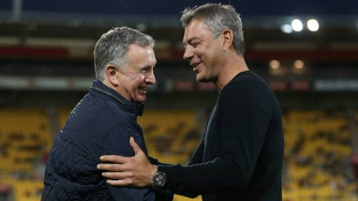 Mark Rudan welcomes former Phoenix coach Ernie Merrick before the clash against Newcastle.
