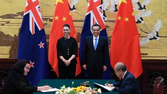 New Zealand Prime Minister Jacinda Ardern, center left, and Chinese Premier Li Keqiang