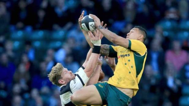 Adam Thomson, on the left, who called rugby to ban Israel Folau, looks for a high ball against Folau in a matchup between the barbarians and Australia at Twickenham in 2014.