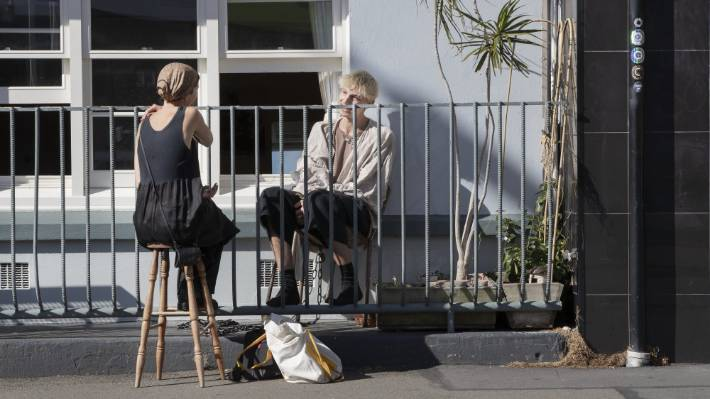 On Upper Cuba Street, friends catch up over a fence social distancing chat.