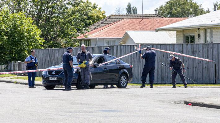 Armed police and search teams examine the cordon Whitefield St, Kaiapoi.