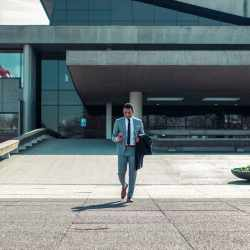 man-walking-business-suit-phone-impact-of-covid-on-broker-dealers