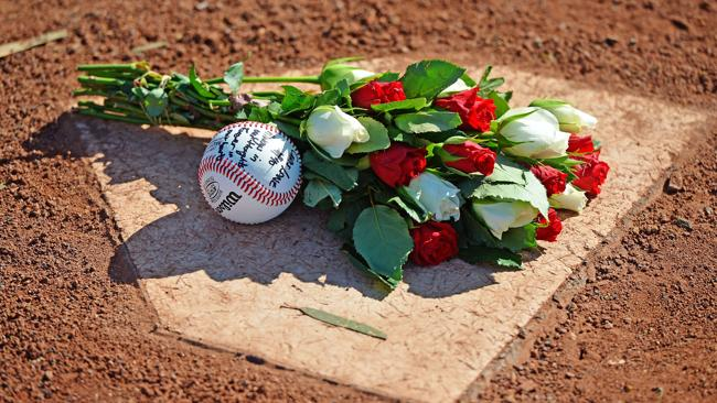 A tribute left on the home plate at Essendon Bombers Baseball field for murdered Melbourne baseballer Christopher Lane.