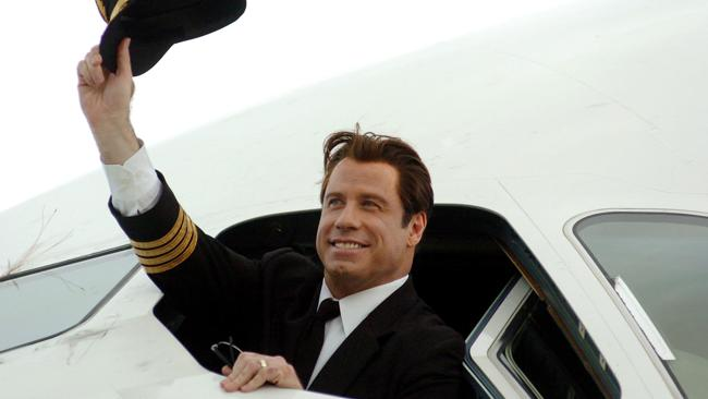 John Travolta makes being a pilot look easy. Picture: AFP/Heather Faulkner