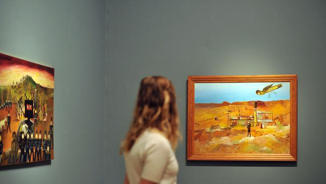 A visitor looks at Sidney Nolan's series in London. Picture: Getty Images