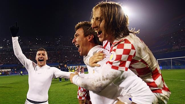 Mario Mandzukic of Croatia celebrates qualification with team mate Luka Modric.