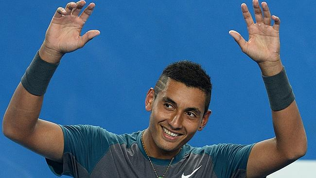 Australia's Nick Kyrgios joins the crowd and performs the mexican wave during his men's singles match against France's Benoit...