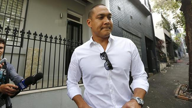 A 'deeply apologetic' Geoff Huegill appears outside his home yesterday to say sorry for t