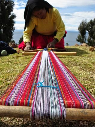 A Taquile woman demonstrates her weaving skills.