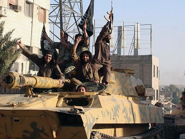 Fighters from the al-Qaeda linked Islamic State of Iraq and the Levant (ISIL) during a pa