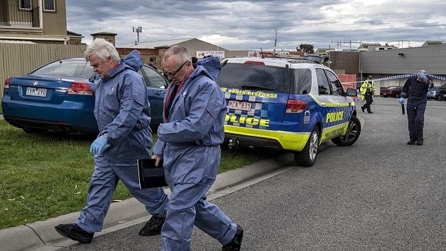 Forensic police outside Endeavour Hills police station. Picture: Getty