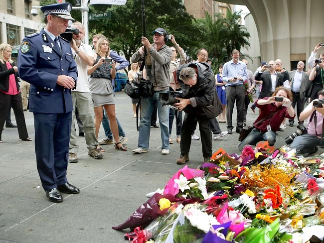 Police Commissioner Andrew Scipione at the Martin Place flower memorial. Governor-general