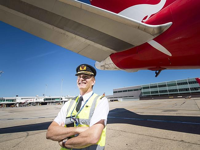 Qantas pilot Captain Mike Galvin checks over the last Boeing 767 before leaving Melbourne