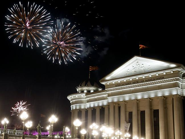 Fireworks explode ... over the Archaeological Museum building in Skopje, Macedonia.