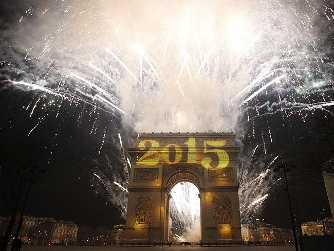 New Year's fireworks erupt ... over the Arc de Triomphe on the Champs-Elysees.
