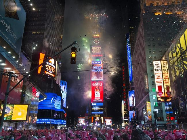 Fireworks erupt after midnight in Times Square, New York. Thousands braved the cold to wa