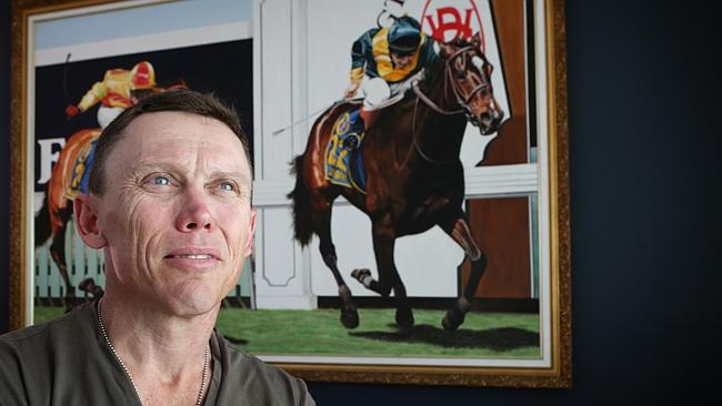 Chris Munce at home with painting of Melbourne Cup winner Jezabeel. Picture: Steve Pohlne