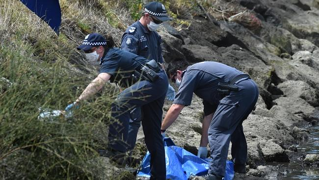 Police tape off the area where more human remains were found whislt they photograph the s