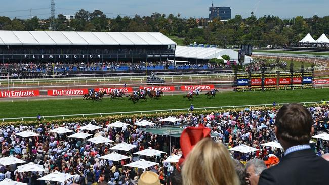 Plenty at stake: A massive crowd gathers on Melbourne Cup Day at Flemington. Picture: Get