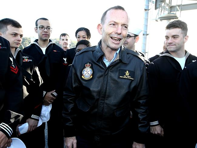 Inspecting the troops ... Mr Abbott speaking with sailors taking part in the Talisman Sab