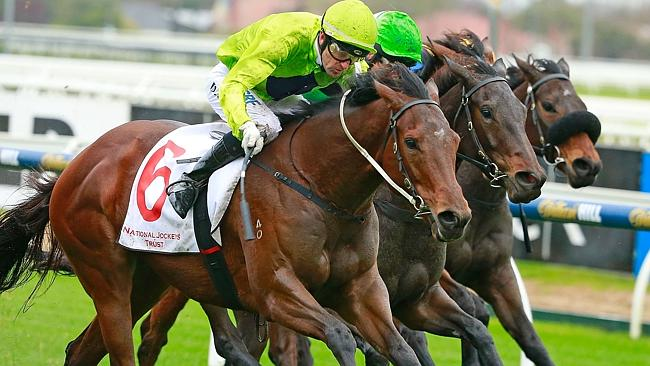 Dwayne Dunn and Pilly's Wish manage to hang on as they are swamped in the Thurgood Family