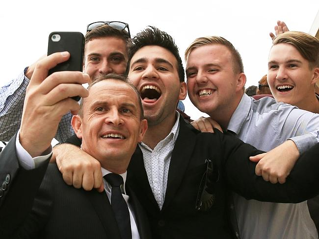 Popular customer Chris Waller is asked to take a selfie with young racing fans on Golden