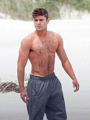 Rarely covered up ... Efron on the set of another upcoming film, Dirty Grandpa.