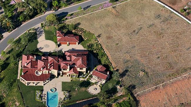 What drought? Some celebrities are keeping their lawns green, as shown in this aerial vie