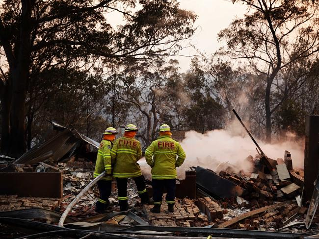 Firefighters keep watch at Buena Vista Rd, Winmalee, in the Blue Mountains.