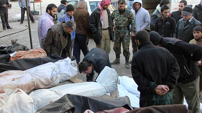 Syrians check the identities of the bodies of victims from an airstrike on the Maadi neighbourhood of the northern Syrian cit...