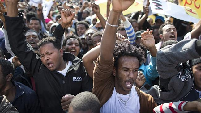 Tens of thousands of African migrants take part in a rally in Tel Aviv, Israel, protesting against a law allowing authorities...