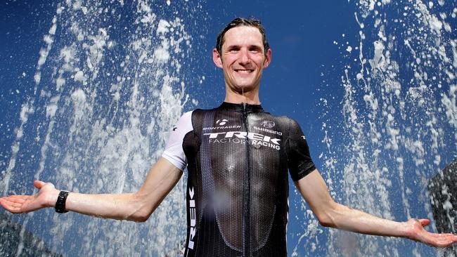 Cyclist Frank Schleck cooling off in the new Victoria Square fountain in Adelaide.