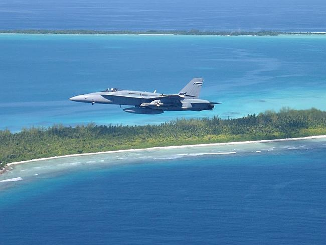 Tropical island ... a file picture of an RAAF jet flying over Diego Garcia in 2002.
