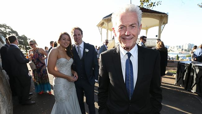Paying more to tie the knot ... celebrant Martin Moroney with newlywed couple Grant and N