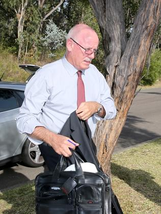 Lawyer Paul Kenny at Rogerson's home today