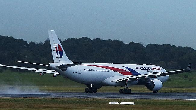 A Malaysia Airlines plane at Adelaide Airport. Picture Simon Cross
