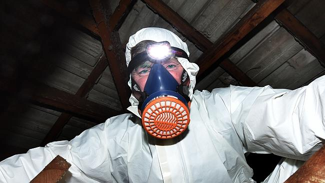 Peter Bird suits up for asbestos inspection in Sunshine North. Picture: Tony Gough