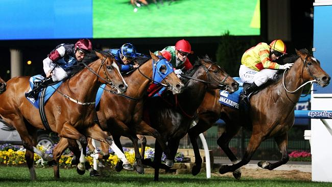 Lankan Rupee (R) hangs on to win the Manikato Stakes from Rebel Dane, Buffering and Angel