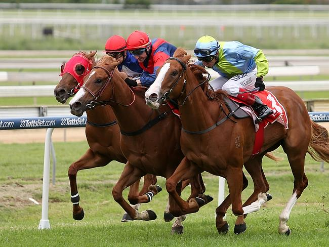 Larry Cassidy and Flamenco (middle) charge through to claim the Calaway Girl Stakes. Pict