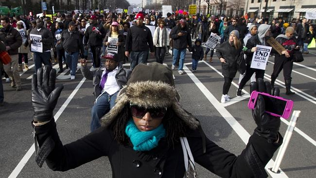 Thousands hit streets over black deaths