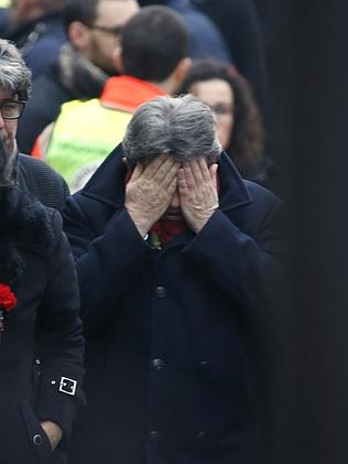 French far-left leader Jean-Luc Melenchon reacts outside of the headquarters of Charlie H