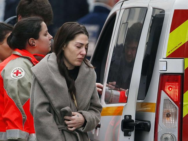 A woman cries outside the headquarters of Charlie Hebdo. Picture: Kenzo Tribouillard