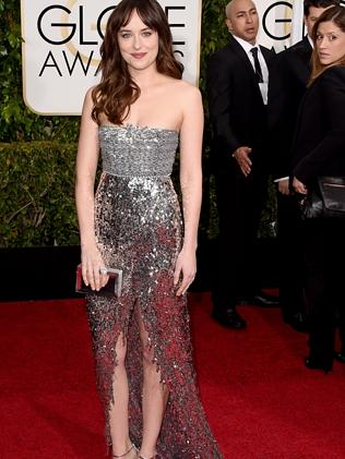 Dakota Johnson wore a metallic, silver ensemble.